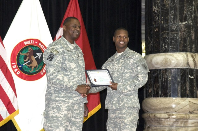 BAGHDAD - Lt. Gen. Lloyd Austin (left), commander, Multi-National Corps - Iraq, congratulates Pfc. Richerson Talleyrand of the 1st Battalion, 7th Field Artillery Regiment, 2nd Heavy Brigade Combat Team, 1st Infantry Division, during his U.S. citizenship ceremony at Camp Victory March 3. Talleyrand, who is from Port-au-Prince, Haiti, serves as a radar equipment generator mechanic.