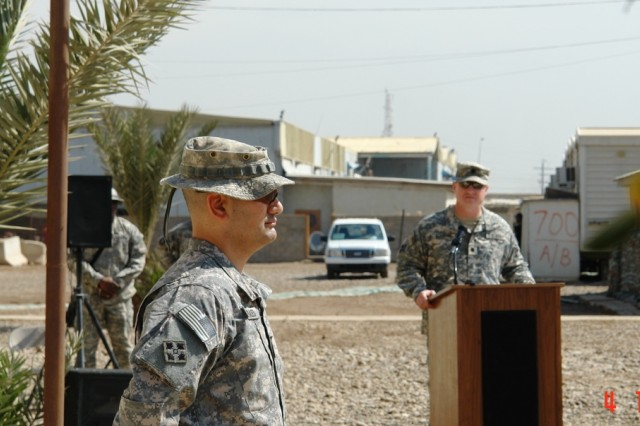 BAGHDAD- El Paso, Texas native, Lt. Col. Rich Morales (left), commander, Task Force 1st Battalion, 35th Armor Regiment, 2nd Brigade Combat Team, 1st Armored Division, Multi-National Division-Baghdad, listens as Lt. Col. Matthew Elledge, commander, 1st Bn., 22nd Infantry Regt., 1st BCT, 4th Inf. Div., speaks during a transfer of authority ceremony at FOB Falcon March 4. The Soldiers of the Fort Hood, Texas based unit ceded responsibility of the West Rashid district area to the 'Iron Knights' of TF 1-35.