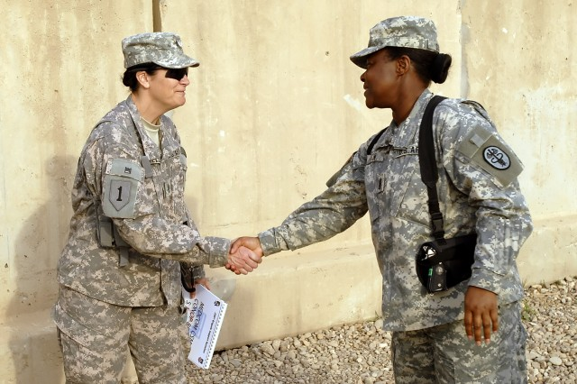"""BAGHDAD - Command Sgt. Maj. Althea Dixon (right), senior enlisted advisor to the Army Surgeon General, U.S. Army Medical Command, shakes hands with Command Sgt. Maj. Julia Kelly, senior enlisted leader, 299th Brigade Support """"Lifeline"""" Battalion, at the Riva Ridge Troop Medical Clinic on Camp Liberty March 5. Dixon flew from the MEDCOM Headquarters at Fort Sam Houston, Texas to meet with the Lifeline battalion's medical Soldiers."""
