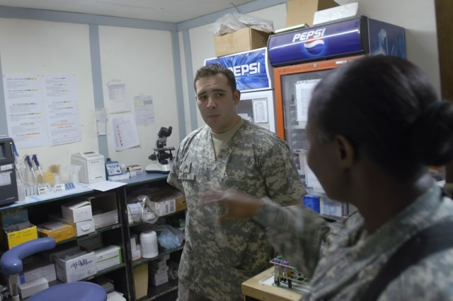 "BAGHDAD - Command Sgt. Maj. Althea Dixon (right), senior enlisted advisor to the Army Surgeon General, U.S. Army Medical Command, speaks with Allentown, Pa. native, Sgt. Adam Funk, a lab technician serving with Company C, 299th Brigade Support ""Lifeline"" Battalion at the Riva Ridge Troop Medical Clinic on Camp Liberty March 5. Dixon met with Lifeline medical Soldiers to talk about changes in the Army Medical Corps and the responsibilities of medical noncommissioned officers."
