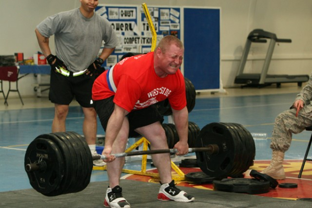 Spc. Joseph Zimmerman, Headquarters and Headquarters Co., 16th Special Troops Battalion, 16th Sustainment Brigade, attempts to dead-lift 551 pounds during the Q-West Powerlifting Quest 1000 at Contingency Operating Base Q-West, Iraq, Feb. 15. Zimmerman, 225 pounds, won the pound-for-pound heavyweight award by lifting 1,411 pounds in three events - the deadlift, bench press and back squat. (Courtesy photo)
