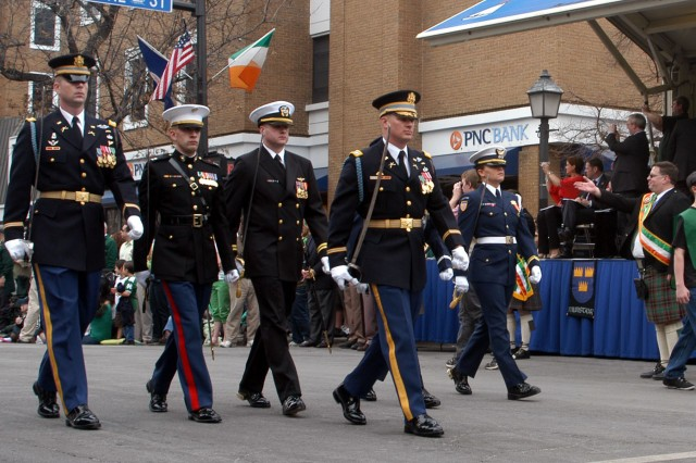 Lt. Col. Michael McNally, the deputy commander of the 3rd U.S. Infantry Regiment (The Old Guard), leads a joint force down the streets of Old Town Alexandria, Va., during the annual St. Patrick's Day Parade.