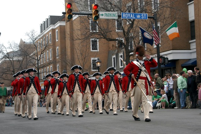 The Old Guard Fife and Drum Corps marches down King St. Saturday in support of the St. Patrick's Day Parade in Old Town Alexandria, Va.
