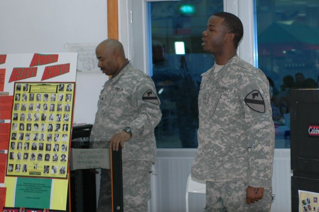 Pvt. Jeffrey Smith, 215th Brigade Support Battalion, 3rd Heavy Brigade Combat Team, 1st Cavalry Division, entertained attendees with a song during the black history celebration held at the FOB Marez dining facility in Mosul, Iraq on Feb 18.