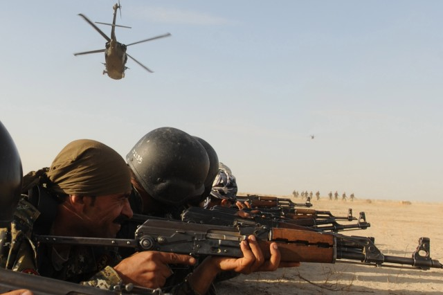 Iraqi policemen, from the Dhi Qar Province pull security during an air assault training event with Soldiers of the 2nd Battalion, 12 Cavalry Regiment, 4th Brigade Combat Team, 1st Cavalry Regiment, at Camp Cedar, Iraq, March 2.