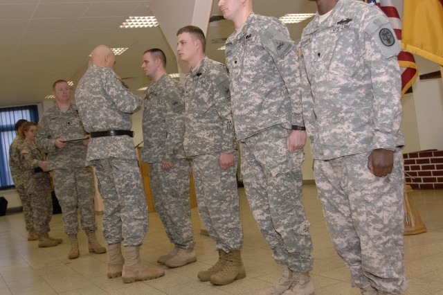 1st Armored Division Soldiers receive medals for valor in Iraq during Baumholder ceremony