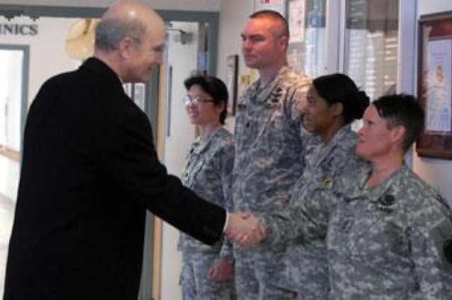 First Sgt. Cari Vande Kamp welcomes Secretary of the Army Pete Geren to Munson Army Health Center Feb. 6, 2008, as he arrives to meet Soldiers who work in MAHC's Warrior Transition Unit. Also greeting Geren were Lt. Col. Vivian Hutson, Lt. Col. Barry Pockrandt and Capt. Tammy Glascoe.""