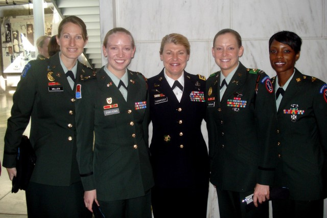 Capt. Lauren Miller, 1st Lt. Emma Sparks-Hedman, GEN Ann Dunwoody, Capt. Erinn Singman, and Spec. Ricketa Patterson joined the First Lady, Michelle Obama at the Women in Military Service to America Memorial on March 3, 2009.