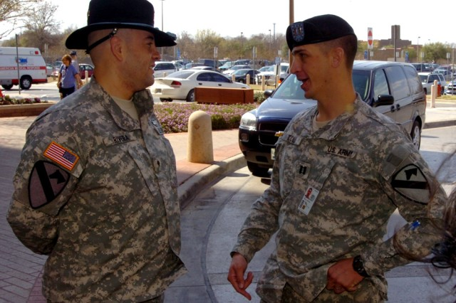 Capt. Russell Toll (right) speaks with former 3rd Heavy Brigade Combat Team, 1st Cavalry Division Soldier Spc. Victor Rivera, March 5, during a visit at Brooke Army Medical Center, San Antonio.