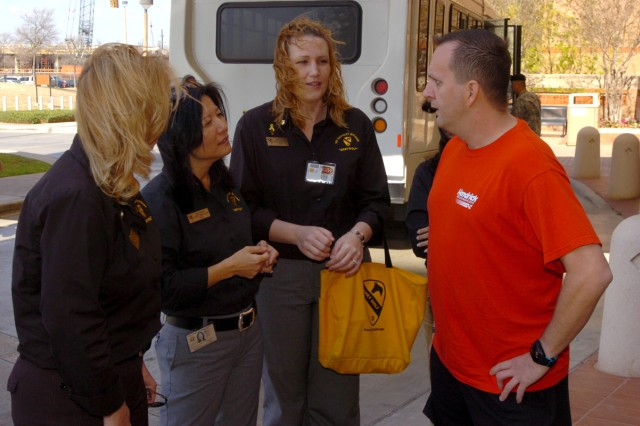 Lori Carpenter (left to right), Suzy Carter, and April O'Neil, Family Readiness Support assistants with 3rd Heavy Brigade Combat Team, 1st Cavalry Division, meets with Cpl. John Hiland, March 5, during a visit to Brooke Army Medical Center in San Antonio.