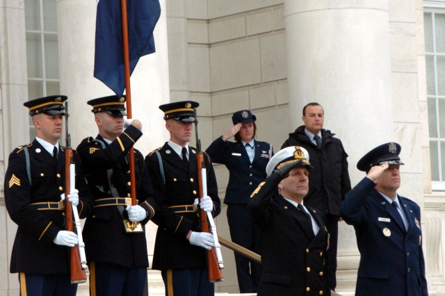 """Admiral Giampaolo Di Paola , the Chairman of the North Atlantic Treaty Organization Military Committee and Maj. Gen. Ralph J. Jodice II, the Commander of the Air Force District of Washington, salute as """"To the Color"""" is played at the Tomb of the Unknown Soldier in Arlington National Cemetery."""