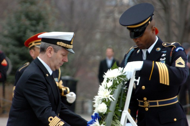 Admiral Giampaolo Di Paola , the Chairman of the North Atlantic Treaty Organization Military Committee places a wreath at the Tomb of the Unknown Soldier in Arlington National Cemetery with assistance from Sgt. 1st Class Alfred Lanier, the Segeant of the Guard at the Tomb.
