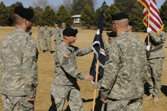 Command Sgt. Maj. Dean R. Parsons passes the unit colors in recognition of his new position as the 117th Space Battalion's new Command Sergeant Major.