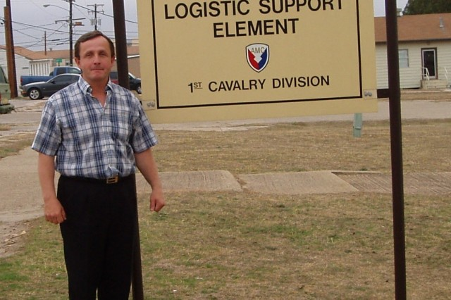 Mark Combs stands outside of the Logistics Support Element office in Fort Hood, Texas, but to JMC headquarters heAca,!a,,cs the Ammunition Logistics Assistance Representative for the 407th Army Field Support Brigade, 1st Cavalry Division.