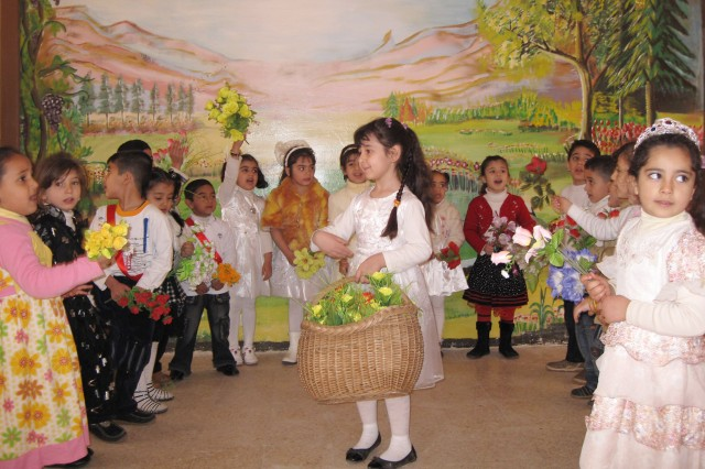 MUSTANSIRYA, Iraq – Children at the Al-Moutasam Kindergarten dance during the school's reopening ceremony March 3 in the Rusafa district of eastern Baghdad. District leaders, school officials, Iraqi Security Forces and paratroopers assigned to 5th Squadron, 73rd Cavalry Regiment, 3rd Brigade Combat Team, 82nd Airborne Division, Multi-National Division – Baghdad were in attendance to commemorate the school's renovation and reopening.