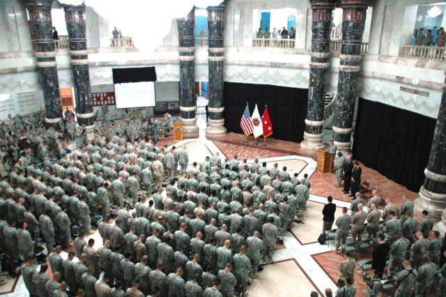 BAGHDAD -Soldiers attending a naturalization ceremony stand in formation March 3 at al-Faw Palace. Sgt. Juan Ramos, an armor crewman with Headquarters and Headquarters Company, 1st Combined Arms Battalion, 18th Infantry Regiment was among the 251 Soldiers who were granted their citizenship at the ceremony.