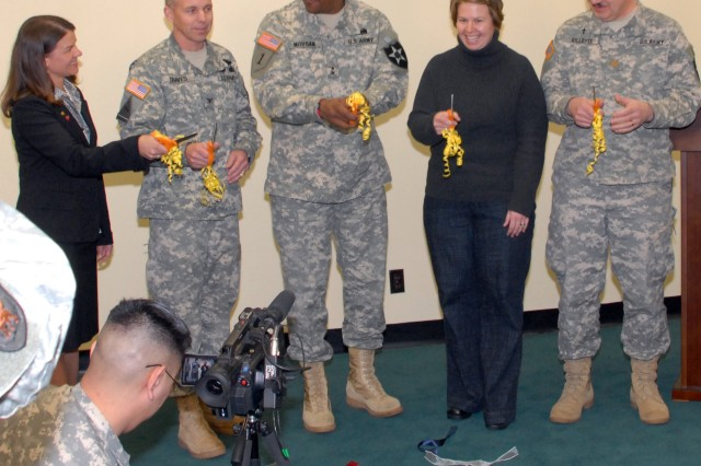 (from left to right) Karen Thomas, wife of Col. Thomas Graves, 1st Heavy Brigade Combat Team commander, Graves, Maj. Gen. John W. Morgan III, 2nd Infantry Division commander, Amy Hickerson, 1st HBCT Family Readiness Support Assistant, and Maj. Robert Gillette, brigade chaplain, smile after cutting the ribbon marking the grand opening of the FRG center at USAG-Casey, March 3. - U.S. Army photo by Pfc. Jamal Walker