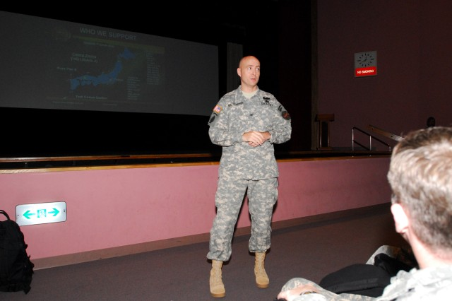 Col. Bob Waltemeyer, U.S. Army Garrison, Japan commander, briefs more than 100 8th Theater Sustainment Command Soldiers and Civilians at the Cultural Community Center, March 4.  Waltemeyer and other Camp Zama garrison officials were on hand to explain what the small post has to offer to these deployed personnel, here for a two-week command post exercise.
