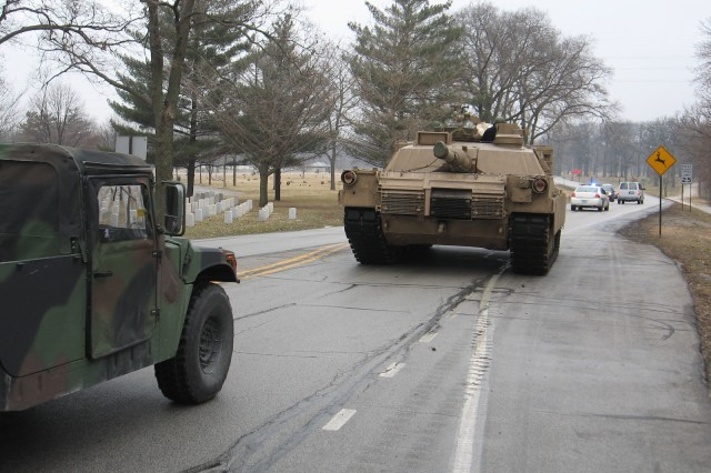 An M1A2 System Enhancement Package version two, the Army's  latest battle tank, rolls down Rodman Avenue on Rock Island Arsenal Feb. 27 on its way to TACOM LCMC Rock Island's Maintenance Operations Procedures Shop where it will be used to support training and maintenance missions.