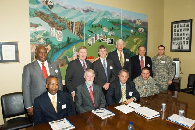 Hinesville, Liberty County and Fort Stewart officials pose with U.S. Senator Johnny Isakson in his office in Washington. The senator is standing, second from the left.