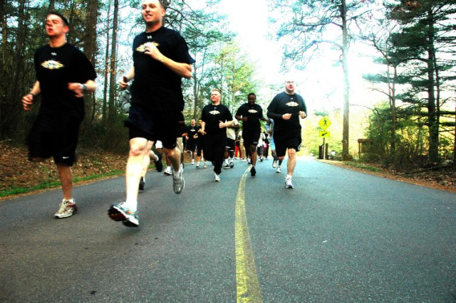 """FORT MCPHERSON, Ga. -- Lead the way! Master Sgt. Christian Carr (second from left), command sergeant major for Hq. Cmd, USAG, lead more than 30 Soldiers up Kennesaw Mountain Mar. 11. The event was in support of the 2009 - Year of the Noncommissioned Officer theme """"Focus on Physical Fitness"""" and involved Soldiers stationed at Forts McPherson and Gillem. This was the second such cohesion building exercise for the garrison, which intends to hold monthly events throughout the year."""