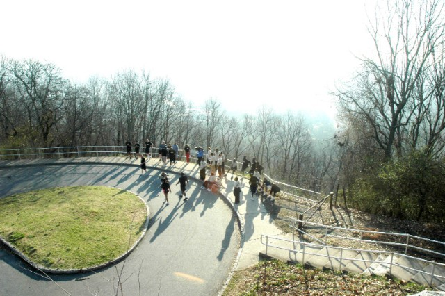 "FORT MCPHERSON, Ga. -- Top of the world, Ma! The Soldiers participating in the USAG hosted ""Fun Run"" for a breather while taking in the breath-taking view at the top of Kennesaw Mountain. They then provided curious on-lookers with a rousing rendition of ""The Soldiers Creed"" before marching back to the historic site's base. The more than 30 Soldiers would return after breakfast for a professional development tour of the Civil War battlefield."