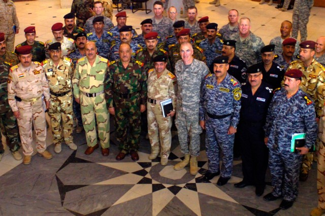 BAGHDAD-Senior Iraqi Army commanders and key Multi-National Division-Baghdad staff members gather together for a photo-op at the conclusion of the Baghdad Commanders Conference March 12.  The meeting afforded both forces the opportunity to frame a common understanding of joint Iraqi and U.S. operations under the security agreement.