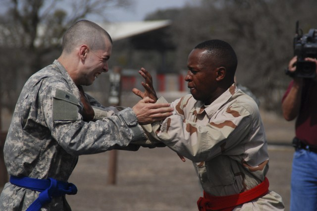 Great Plains Regional Medical Command Soldier of the Year Spc. Jonathan Jordan and Soldier of the Year candidate Spc. Ewen Tesot prepare to battle during the combatives tournament phase of the Great Plains Regional Medical Command NCO and SOY competition on Feb. 25 at Camp Bullis in San Antonio. Jordan won the SOY combatives and the overall competition.