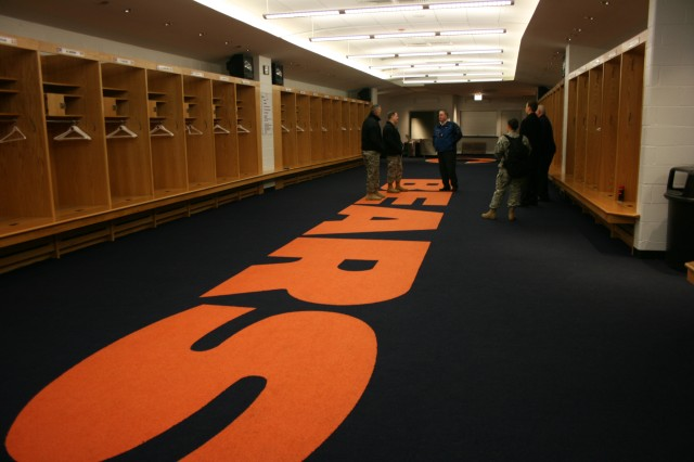 Maj. Gen. Kevin Bergner, Chief of Army Public Affairs, visits the Chicago Bears locker room during a tour of Soldier Field with General Manager, Tim LeFevour, while visiting Chicago, Wednesday, March 11, 2009.