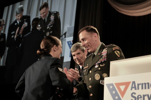 U.S. Air Force Staff Sgt. Stephanie Cates receives the Angels of the Battlefield Award from U.S. Army Gen. David Petraeus, commander, U.S. Central Command, and U.S. Air Force Chief of Staff Gen. Norton A. Schwartz, during a dinner in honor of military medics and corpsman at the Ronald Reagan Building in Washington, D.C., March 11, 2009.