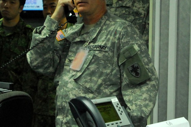 """Col. Steve Fraunfelter, forward command post director, takes a phone call in the forward command post, March 11 at Camp Zama, Japan.  The 8th TSC deployed their forward command post to Camp Zama to test the capabilities of their forward command post during a two-week command post exercise at the U.S. Army, Japan command center. """""""