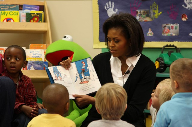 First Lady Michelle Obama reads 'The Cat in the Hat' to children in Ms. Mattie's class at Prager Child Development Center March 12, during her visit to Fort Bragg, N.C. The First Lady spoke with Soldiers and family members as part of her initiative to care for military families.