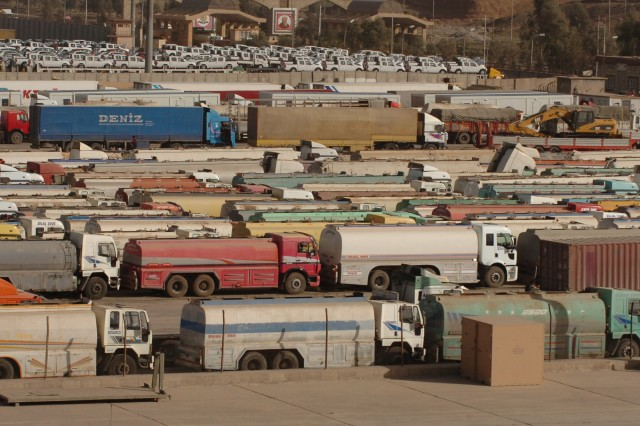 Hundreds of fuel trucks wait to move into Iraq as they are staged at the 609th Movement Control Team's staging yards located at Habur Gate, Iraq. The 609th MCT validates, receives, stages, and monitors the movement of cargo shipped into Iraq for Coalition forces. (U.S. Army photos by Spc. Michael Behlin)