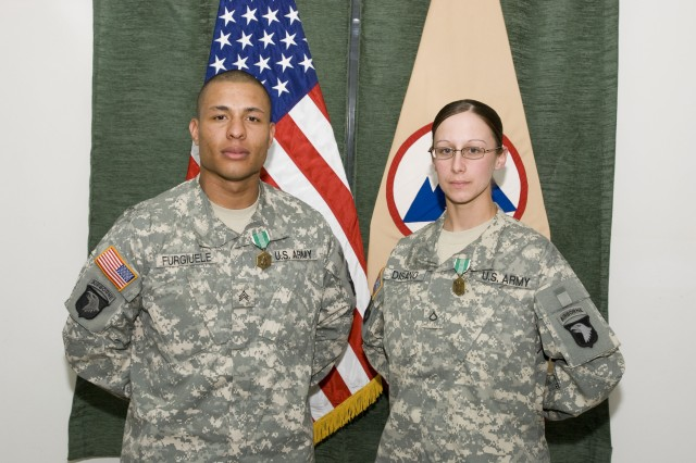 """Sgt. Kellyn L. Furgiuele and Pfc. Christina R. Disano won the 3d Sustainment Command (Expeditionary) Noncommissioned officer and Soldier of the Quarter board held at Joint Base Balad, Iraq, Feb. 20. Furgiuele, native of Fresno, Calif. and convoy support center NCO, 372nd Inland Cargo Transport Company, 371st Sustainment Brigade and Disano, a native of Brattleboro, Vt., and motor transport operator with the 233rd Transportation Company, 16th Sust. Bde., competed against eight other Soldiers representing the five sustainment brigade from the 3d ESC. """"You represent the best of the best,"""" said Command Sgt. Maj. Willie C. Tennant Sr., 3d ESC command sergeant major.  (U.S. Army photo by Spc. Brian A. Barbour)"""