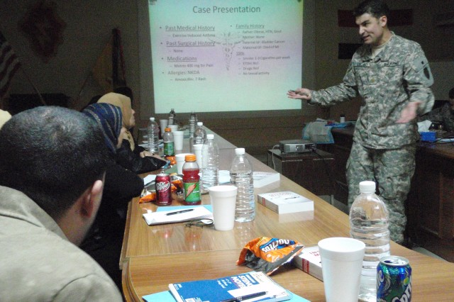 Maj. Brent Lechner, surgeon for the 3rd Sqdn., 4th U.S. Cav. Regt. of the 3rd Inf. Bde. Combat Team, 25th Inf. Div. gives a presentation on kidney disease to Iraqi medical professionals during a medical conference held at Forward Operating Base Paliwoda, near Balad, Iraq.