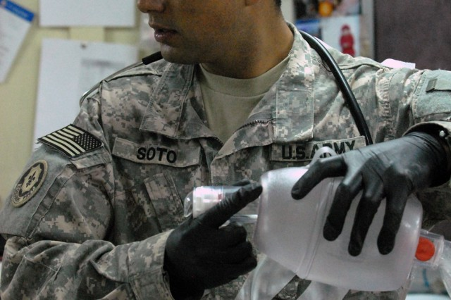 CAMP LIBERTY, Iraq -Amid the beeps of medical monitoring equipment and the barking of orders, Sgt. Sergio Soto, from Lafayette, Colo., 299th Brigade Support Battalion, 1st Infantry Division,, stays focused on his monitor and prepares a bag valve mask that will maintain his casualty's airway.
