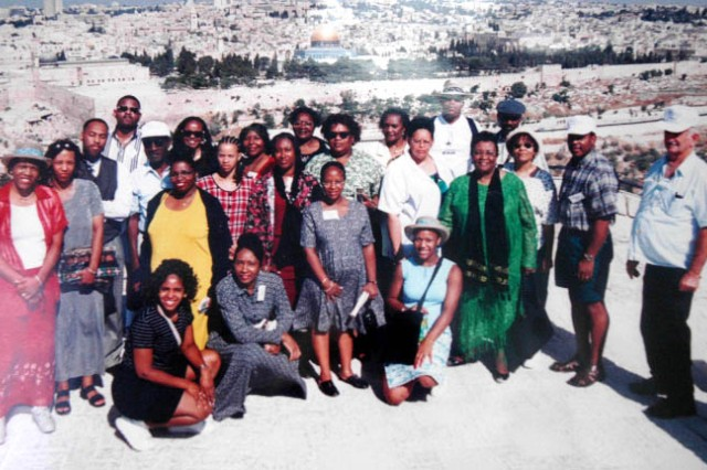 Baker McNair (at left, in red), management analyst and mass transit coordinator for the U.S. Army Garrison Directorate of Resource Management stands with members of Eagles Mount Evangelistic Outreach Ministry during a trip to Jeruselum. In addition to duties on Fort McPherson, McNair serves as a Christian missionary.
