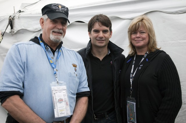 Retired Master Sgt. Ed Brodey, NASCAR Sprint Cup Series driver Jeff Gordon, and BrodeyAca,!a,,cs wife, Linda, pose beside a tent in the Daytona Fan Zone just outside Turn 1 of Daytona International Speedway prior to the 51st running of the Daytona 500.