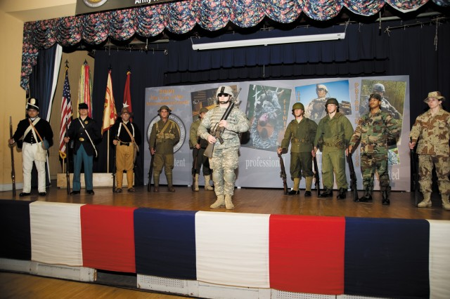 Students from the U.S. Army Ordnance Mechanical Maintenance School's Basic Noncommissioned Officer Academy model Army uniforms of the past and present during the Year of the NCO kickoff celebration at the Aberdeen Area Recreation Center Feb. 24.