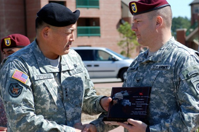 Lt. Gen. Joseph F. Peterson, deputy commanding general, U.S. Army Forces Command, left, presents the 1st Brigade Combat Team commander, Col. Mark R. Stammer, with the Composite Risk Management Safety Award March 5. The 1st BCT won the CRM Safety Award for drastically reducing its number of accidents while deployed to Iraq in 2008.