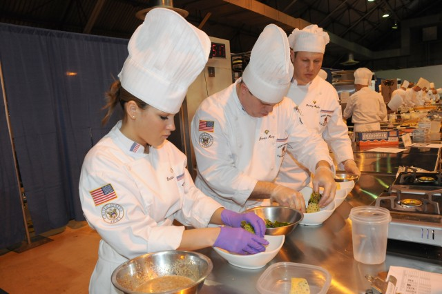 A group of culinarians from the Fort Bragg team compete in the Student Skills Competition, during the 34th U.S. Army Culinary Arts Competition at Fort Lee, Va.