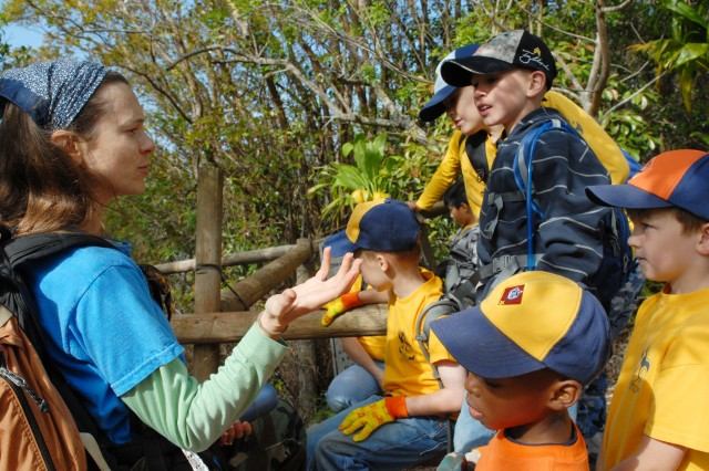 WAIANAE, Hawaii - Candace Russo, Environmental Outreach Specialist, gives Pack 442 's cub scouts safety tips before hiking into Kahanahaiki to help restore native Koa forest.