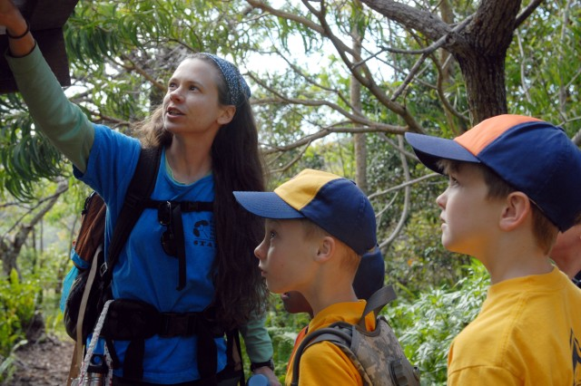 WAIANAE, Hawaii - Candace Russo, environmental outreach specialist, discusses how cub scouts of Pack 442 can make choices which will help protect threatened and endangered species along the trail to Kahanahaiki.