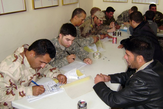 CONTINGENCY OPERATING BASE SPEICHER, TIKRIT, Iraq - Local Sons of Iraq register at the Joint Security Station in Ash Sharqat Mar. 2, assisted by 4th Iraqi Army Division soldiers and Soldiers of 2nd Battalion, 27th Infantry Regiment, 3rd Infantry Brigade Combat Team, 25th Infantry Division. More than 50 Sons of Iraq from the Ash Sharqat region registered in the program, which will transition from U.S. to Iraqi management and funding May 1.