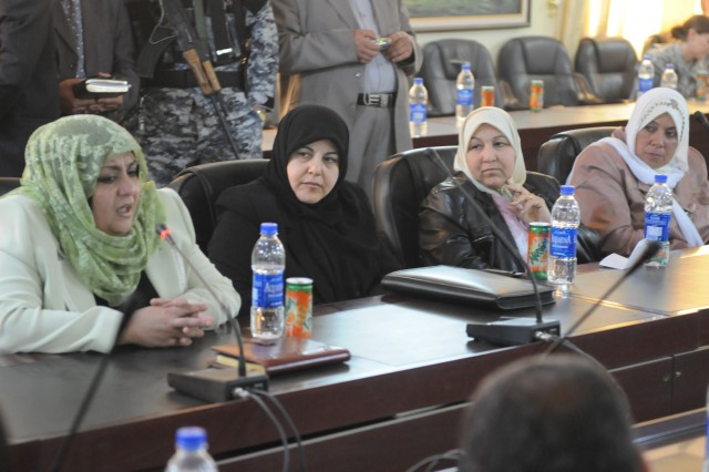 CONTINGENCY OPERATING BASE SPEICHER, TIKRIT, Iraq - Salah ad-Din Provincial Councilwomen listen as newly elected Councilwoman Fatin Abed-Al-Quader Lateef Abed speaks during an informal meeting of former and newly elected council members in Tikrit Mar. 1.