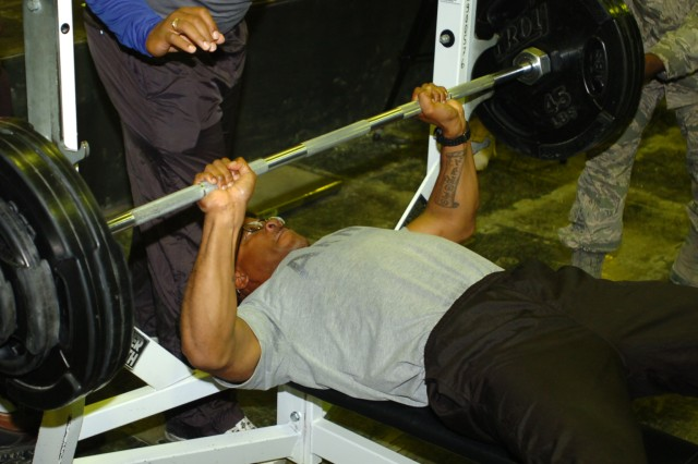 Sgt. Gregory Gayfield, a Radcliff, Ky., native and food service specialist for the 3d Sustainment Command (Expeditionary), works hard to bench-press 285 pounds during a recent competition here. Gayfield placed fifth in the competition which sought the strongest pound-for-pound competitor on Joint Base Balad, Iraq. (U.S. Army photos by Spc. Michael Behlin)