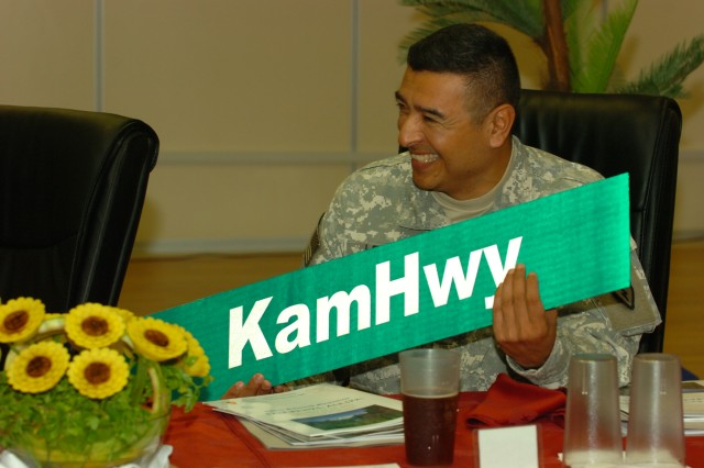 """Command Sgt. Maj. Frank M. Leota, command sgt. maj., 25th Inf. Div., displays the new """"Kamehameha Highway"""" street sign, which was presented for the deployed Tropic Lightning Soldiers at Contingency Operating Base Speicher, near Tikrit, Iraq, March 11. A road similar to Oahu's famous highway will be renamed to honor the Hawaiian roots of the 25th Inf. Div. (U.S. Army photo by Pfc. Jesus J. Aranda, 25th Infantry Division Public Affairs)"""