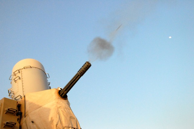 A 20mm round penetrates a plume of smoke as the land-based Phalanx weapons battery conducts a test fire March 7, on Camp Victory, Iraq.