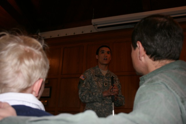 Spc. Steven Baskis, an infantryman who served with the 4th Infantry Division in Iraq, speaks during a breakfast at Grace Episcopal Church Saturday, March 14 as Torrey Foster and his son, Torrey Jr. look on.