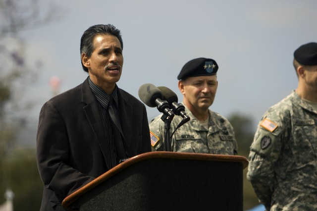 """Lt. Gov. James """"Duke"""" Aiona Jr. says mahalo to the troops of 2nd Stryker Brigade Combat Team during a redeployment ceremony on Sills Field March 12."""